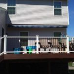 Outside deck with table and chairs.