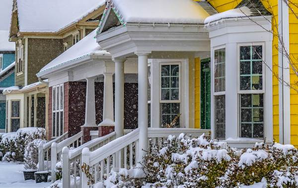 Yellow colored home with white trim.
